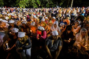 A candle light vigil is held Tuesday night, Aug. 7, in Oak Creek, Wis., for the victims three days after a mass shooting at the Sikh Temple of Wisconsin. The vigil was held during the national night out event at the Oak Creek Civic Center.  Tom Lynn/AP